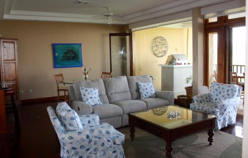 A seating area at Presedential Suites