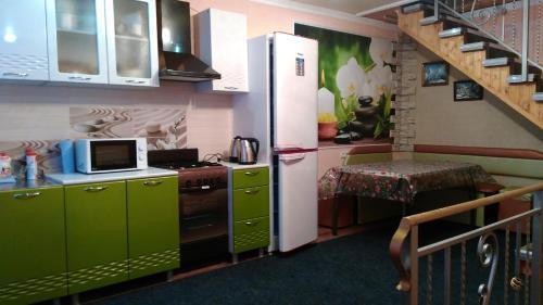 Кухня или мини-кухня в Дом для отдыха Анжела