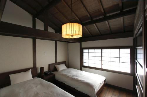 A bunk bed or bunk beds in a room at Azuki an Machiya House