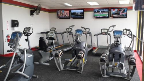 The fitness center and/or fitness facilities at Super 8 by Wyndham Blackwell