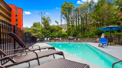 The swimming pool at or near SureStay Plus Hotel by Best Western Gatlinburg
