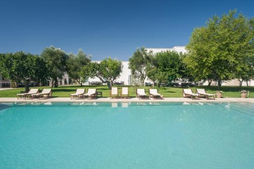 The swimming pool at or near Masseria Montelauro