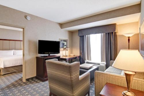 A television and/or entertainment centre at Homewood Suites by Hilton Toronto-Oakville