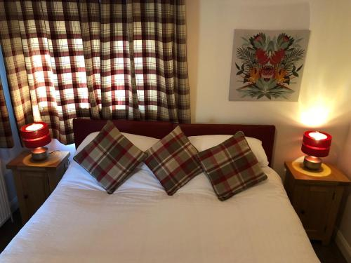A bed or beds in a room at The Wee Lodge