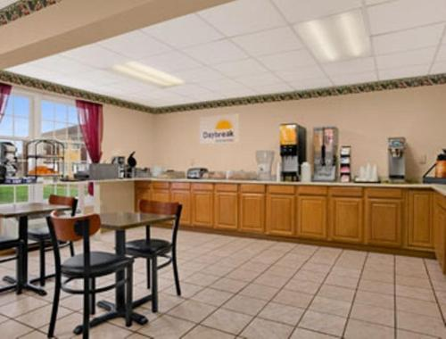 A restaurant or other place to eat at Days Inn by Wyndham Madisonville
