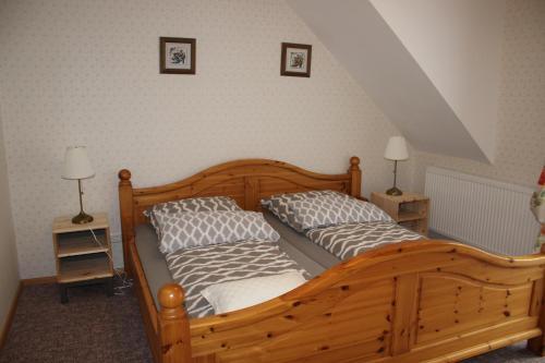 Ein Bett oder Betten in einem Zimmer der Unterkunft Posthotel