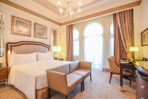 A bed or beds in a room at Waldorf Astoria Jerusalem