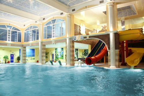 The swimming pool at or near Astral Hotel Complex C