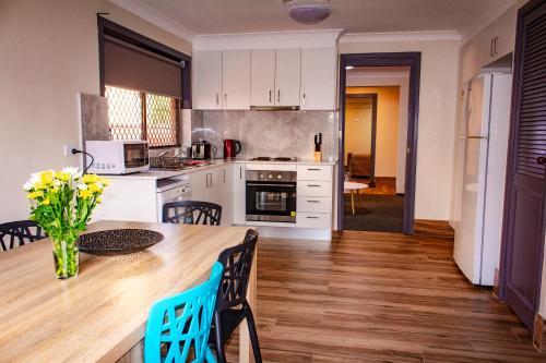 A kitchen or kitchenette at Liberty Plains Motor Inn