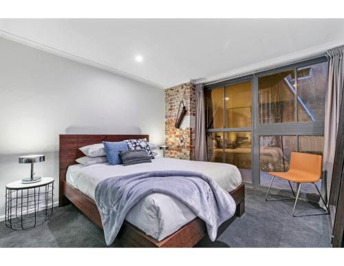 A bed or beds in a room at Chic warehouse apartment in hipster, foodie hub