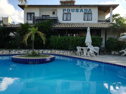 The swimming pool at or near Pousada Poesia