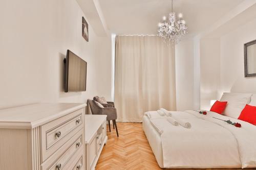 Ein Bett oder Betten in einem Zimmer der Unterkunft S&S Royal Klimentska
