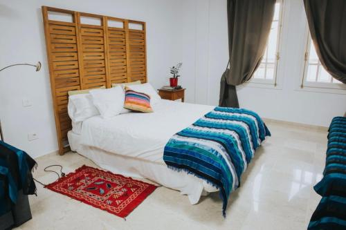 A bed or beds in a room at Home Bassou