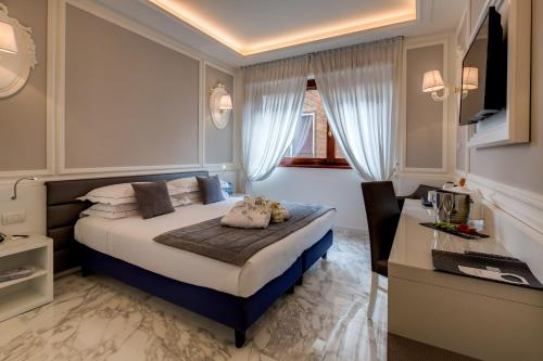 A bed or beds in a room at Grande Albergo Roma