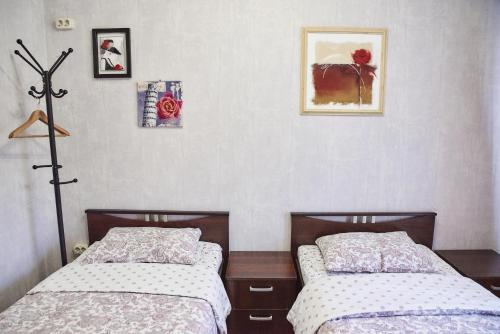 Кровать или кровати в номере Хостел ХотХос