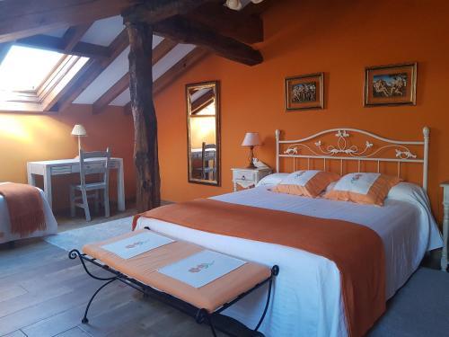 A bed or beds in a room at Posada La Rivera De Escalante