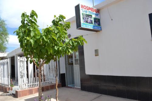 Una televisión o centro de entretenimiento en Hospedaje Las Termas
