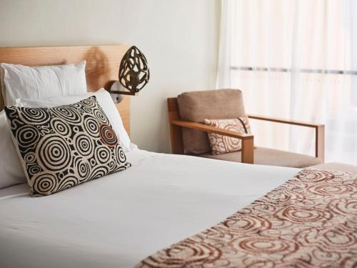 A bed or beds in a room at Sails in the Desert