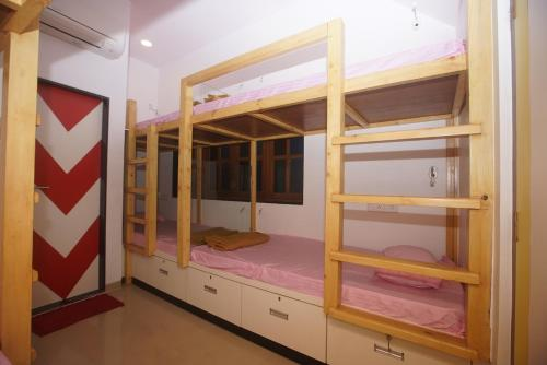 A bunk bed or bunk beds in a room at Mumbai Staytion Dorm- Hostel
