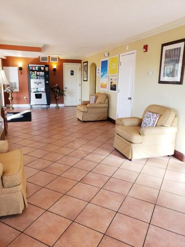 The lobby or reception area at Days Inn by Wyndham Kissimmee West