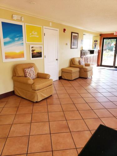 A seating area at Days Inn by Wyndham Kissimmee West