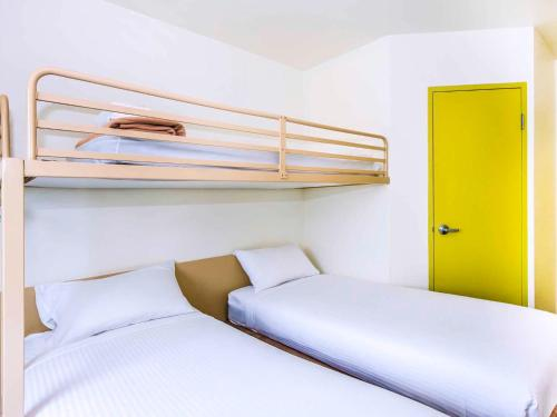 A bunk bed or bunk beds in a room at ibis Budget Coffs Harbour