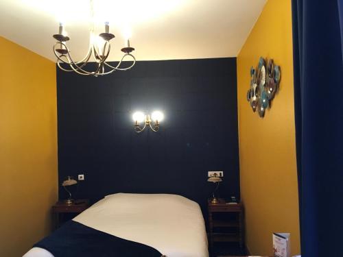Een bed of bedden in een kamer bij Le Florence
