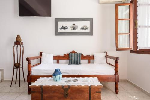 A bed or beds in a room at Villa Notos