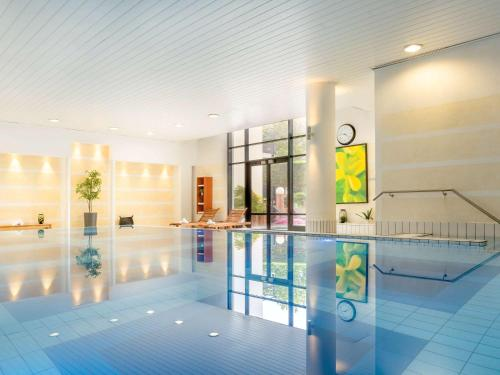 The swimming pool at or near Novotel Paris Roissy CDG Convention