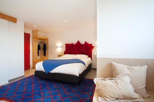 Un ou plusieurs lits dans un hébergement de l'établissement Ô Macra B&B