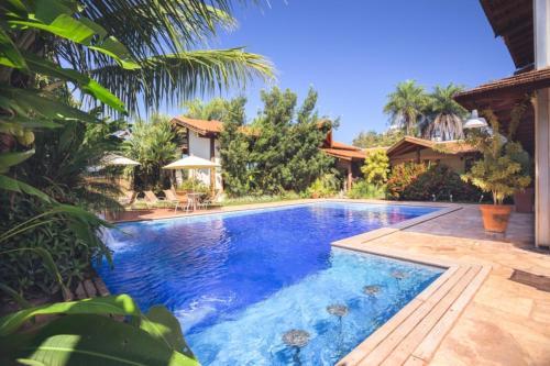 A piscina localizada em Pousada Chamamé ou nos arredores