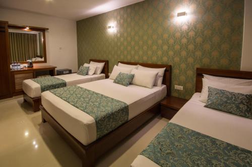 Ceyloni City Hotelにあるベッド
