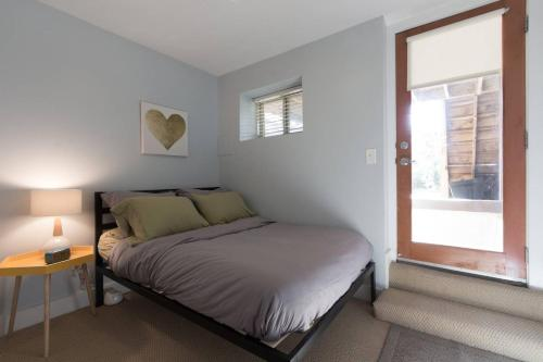 A bed or beds in a room at Charming 2BD in Hip Neighborhood - 3 Blks to Metro