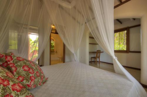 A bed or beds in a room at Casa Natureza Brasil