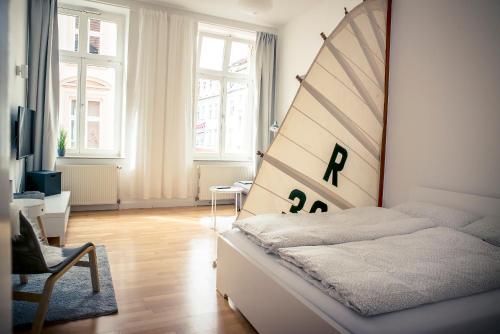 Ein Bett oder Betten in einem Zimmer der Unterkunft Schwerin City Apartment