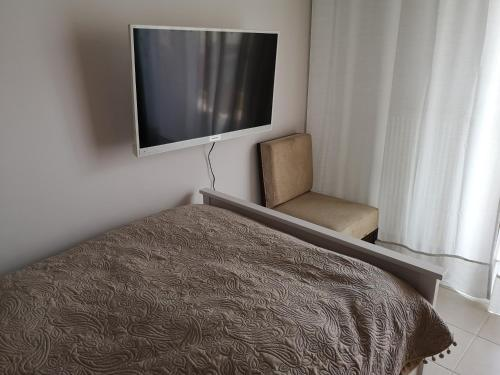 A bed or beds in a room at Heraklion Center Sea View Flat