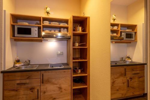 Küche/Küchenzeile in der Unterkunft Hotel Zum Rosengarten