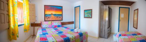 A bed or beds in a room at Brisa do Caitá Praia Hotel