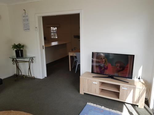A television and/or entertainment center at Dromana Holiday Beach House
