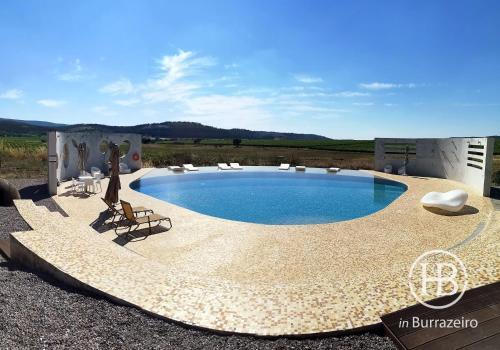 The swimming pool at or near Herdade do Burrazeiro