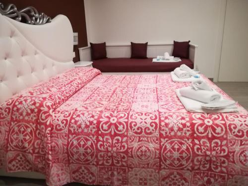 Voodi või voodid majutusasutuse La Perla Di Angelica toas