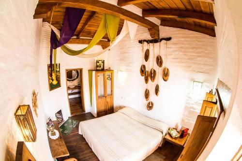 Cama o camas de una habitación en Hotel La Casona