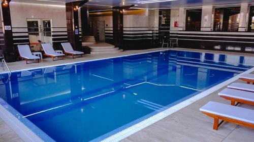 The swimming pool at or near Hotel International Prishtina & Spa