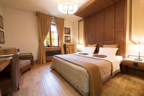 Postelja oz. postelje v sobi nastanitve Hotel Grad Otočec - Relais Chateaux