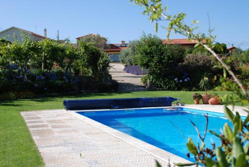 The swimming pool at or near Quinta da Dinha
