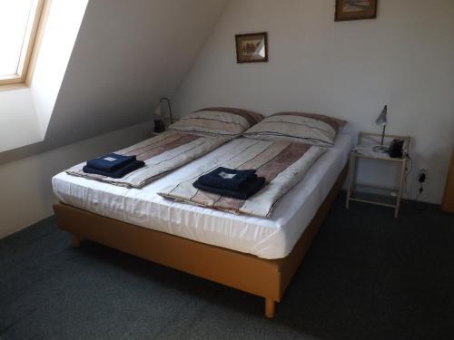 Postel nebo postele na pokoji v ubytování Penzion Signum Laudis
