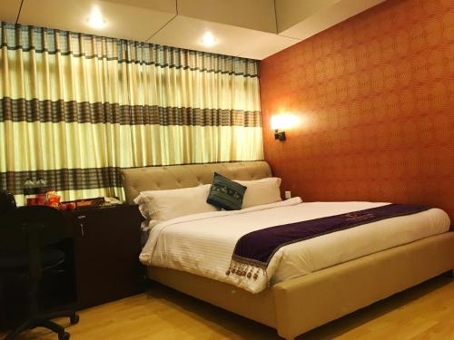 A bed or beds in a room at Century Park Residence