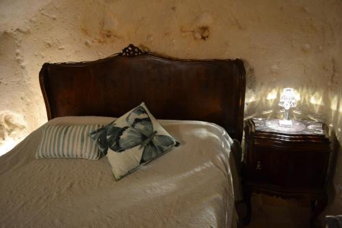 Letto o letti in una camera di L'eremo del cardinale