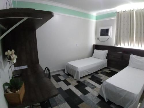 A bed or beds in a room at Lodi Express Hotel