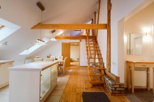 A kitchen or kitchenette at Old Riga Kaleju Loft Apartment